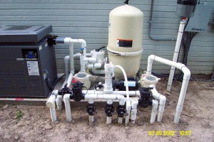 Half on/half off pool equipment with heater, concrete pad, full plumbing.